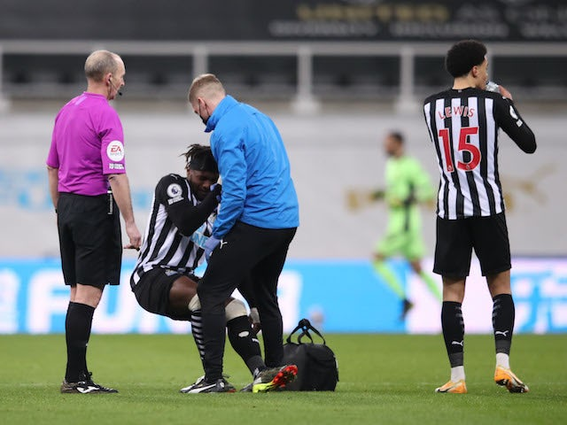 Newcastle winger Allan Saint-Maximin receives treatment for an injury on February 27, 2021