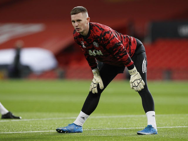 Dean Henderson warms up for Manchester United on February 25, 2021
