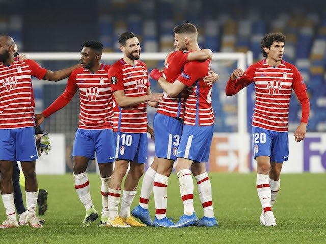 Granada players celebrate Napoli's Europa League victory on February 25, 2021
