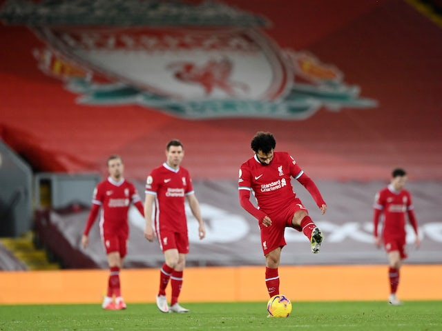 Liverpool players seem discouraged after conceding goals to Manchester City in February 2021