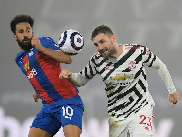 Manchester United's Luke Shaw in action with Crystal Palace's Andros Townsend in the Premier League on March 3, 2021