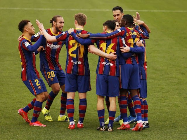 Barcelona's Ousmane Dembele celebrates his first goal with teammates on February 27, 2021