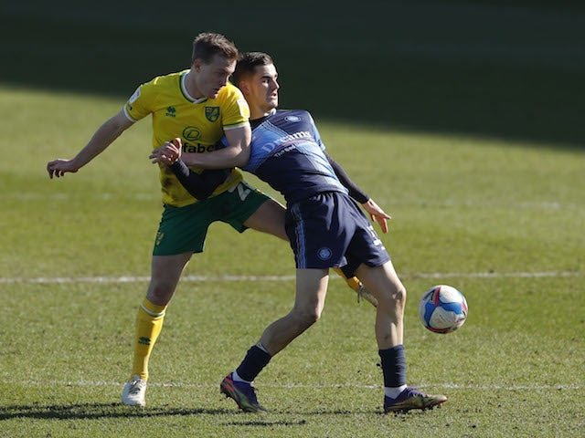 Norwich City's Oliver Skipp in action with Wycombe Wanderers' Anis Mehmeti in the championship on February 28, 2021