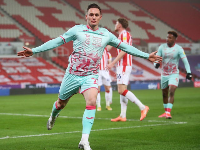 Connor Roberts of Swansea City celebrates his goal against Stoke City in the league on March 3, 2021
