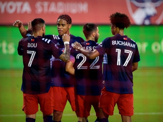 New England Revolution forward Gustavo Bou celebrates the goal with his teammates on June 28, 2021