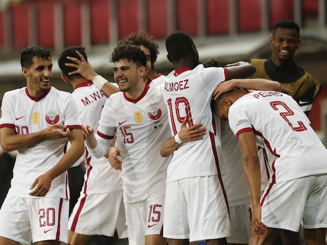 Hassan Al Haydos of Qatar celebrates his second goal with his teammates on March 27, 2021