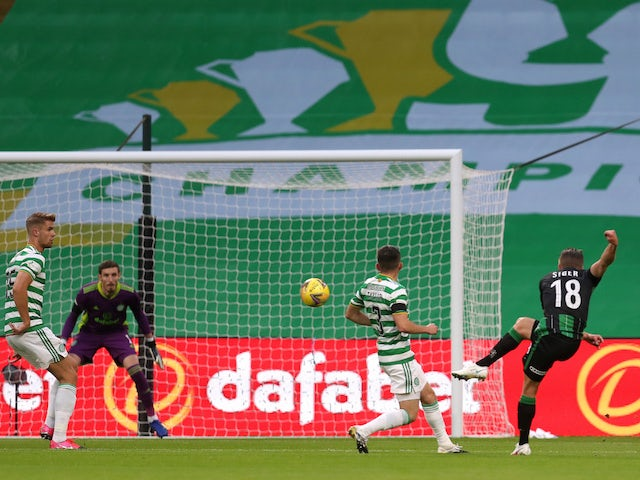 David Siger of Ferencvaros scores against Celtic in the Champions League on August 26, 2020