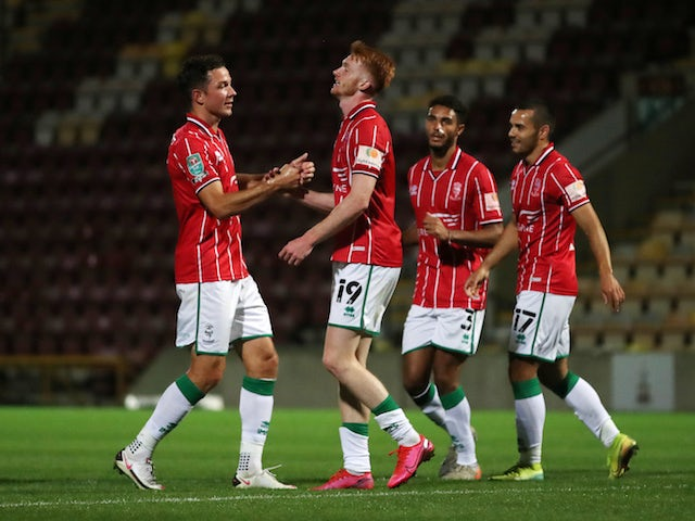 Lincoln City players celebrate scoring against Bradford in the EFL Cup in September 2020