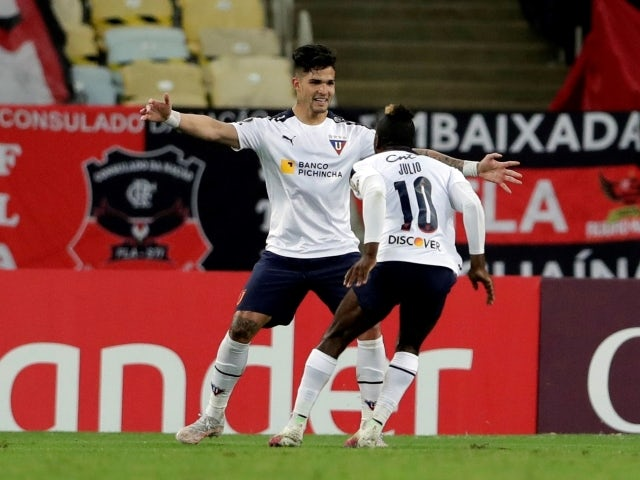 Jhojan Julio of LDU Quito celebrates his second goal with his teammates on May 20, 2021