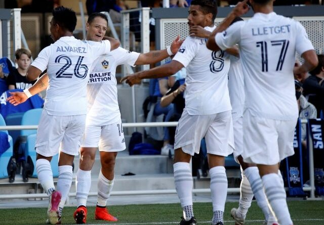 Los Angeles Galaxy forward Javier Hernández celebrates with teammates after scoring a goal on June 27, 2021