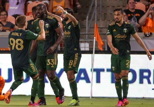 Portland Timbers forward Jeremy Ebobisse celebrates with his teammates after scoring a goal during stoppage time on June 24, 2021