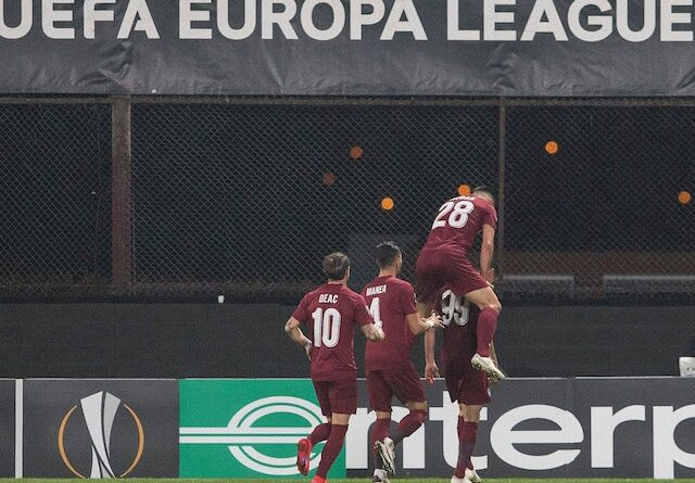 CFR Cluj players celebrate scoring against Young Boys in October 2020