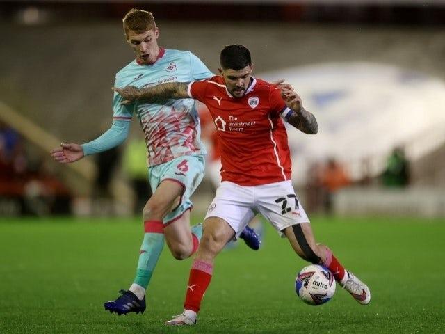 Barnsley's Alex Mowatt collides with Swansea City's Jay Fulton May 17, 2021