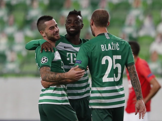 Ferencvaros' Miha Blazic celebrates with teammates against Molde in the Champions League playoffs on September 29, 2020