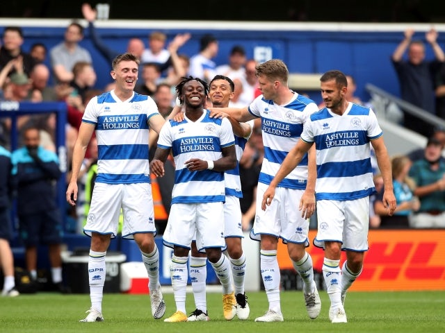 Queens Park Rangers' Moses Odubajo celebrates with his teammates on July 24, 2021
