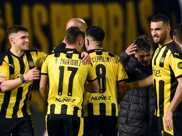 Penarol players celebrate after their game against Nacional on July 22, 2021