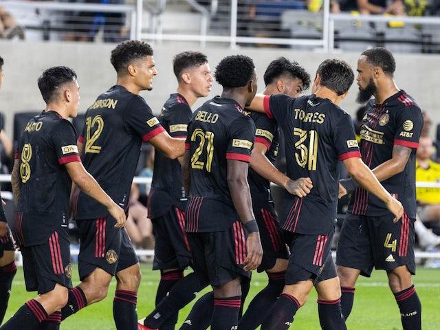 Atlanta United midfielder Marcelino Moreno (10) celebrates with his teammates after scoring a second-half goal against Columbus Crew at Lower.com Stadium on Aug. 7, 2021