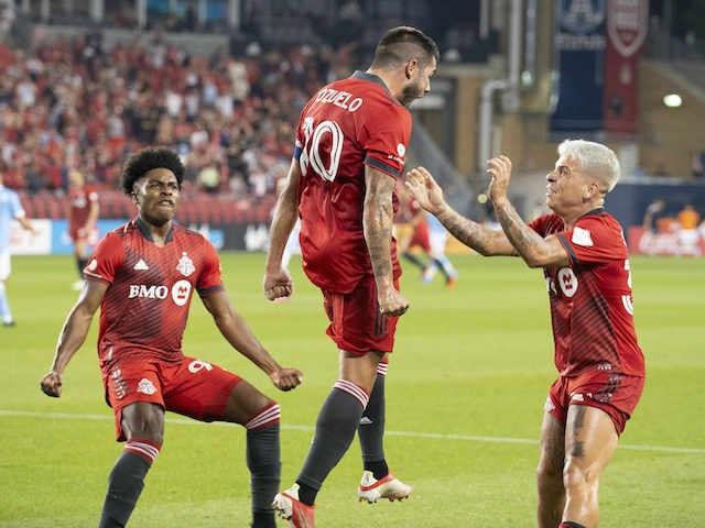 Toronto FC midfielder Alejandro Pozuelo (10) celebrates with midfielder Yeferson Soteldo (30) after scoring against New York City FC in the second half at BMO Field on August 7, 2021