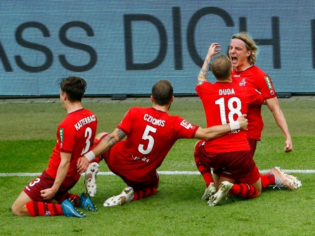 Sebastiaan Bornauw from FC Köln will celebrate his first goal with his teammates on May 22, 2021