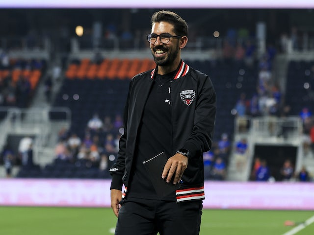 DC United head coach Hernan Losada smiles as he leaves the field after the first-half game against FC Cincinnati at TQL Stadium on July 31, 2021
