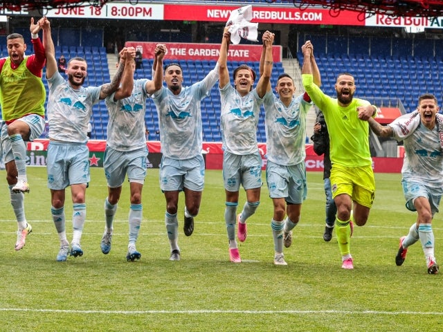 New York Red Bulls teammates celebrate after the game against Orlando City SC on May 29, 2021