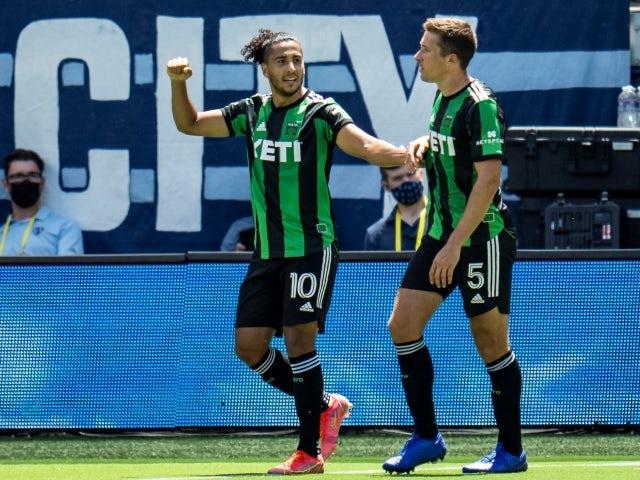 Austin FC striker Cecilio Dominguez celebrates with defender Matt Besler after scoring on June 12, 2021