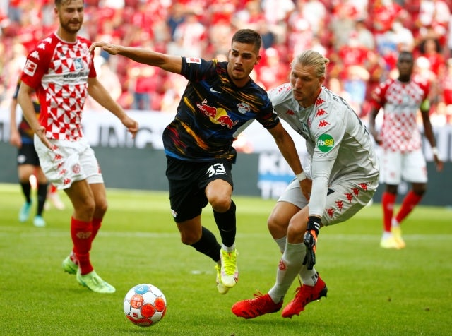 Andre Silva from RB Leipzig in action with Robin Zentner from Mainz 05 on August 15, 2021