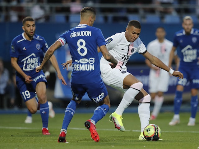 Kylian Mbappe of Paris Saint-Germain in action with Jimmy Giraudon of Troyes on August 7, 2021