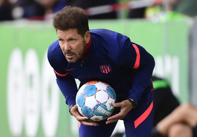 Atletico Madrid coach Diego Simeone holds the ball during the game on July 31, 2021