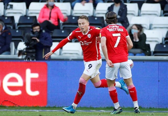 Barnsley's Cauley Woodrow will celebrate his first goal with Callum Brittain in May 2021