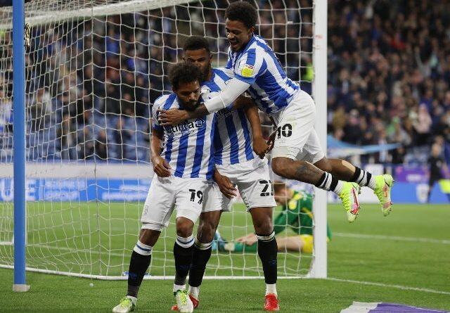 The Huddersfield Town players celebrate after Preston North End's Sepp Van Den Berg scored an own goal in the championship on August 17, 2021
