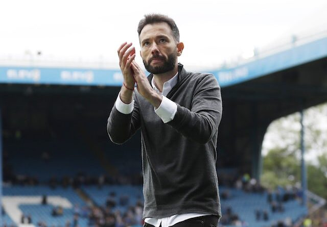 Huddersfield Town Manager Carlos Corberan applauds the fans after the game on August 1, 2021