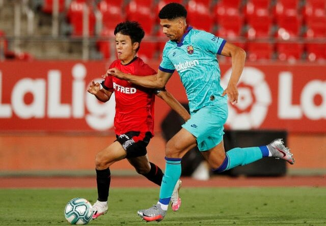 Barcelona defender Ronald Araujo in action with Mallorca's Takefusa Kubo in June 2020