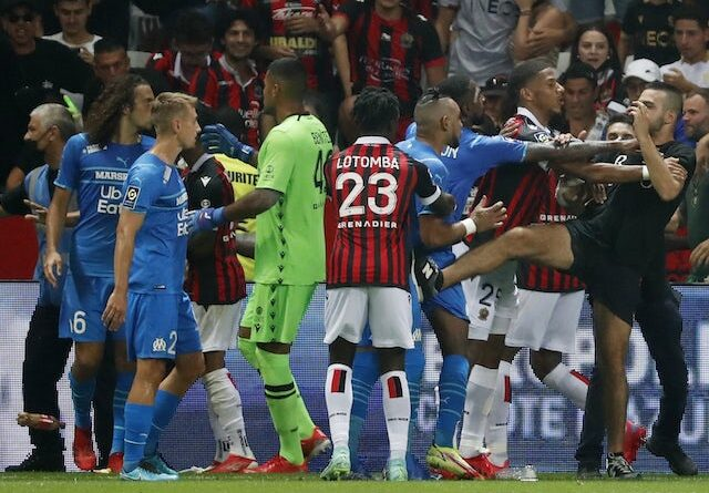 Pitch Invaders face players as the game between Marseille and Nice is suspended on August 22, 2021