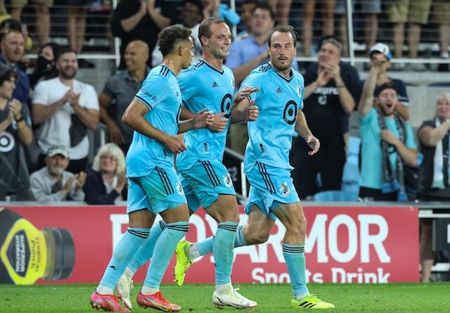 Minnesota United midfielder Hassani Dotson (31) and defender Chase Gasper (77) celebrate a goal after defender Brent Kallman (14) scored against Houston Dynamo in the second half at Allianz Field on August 7, 2021
