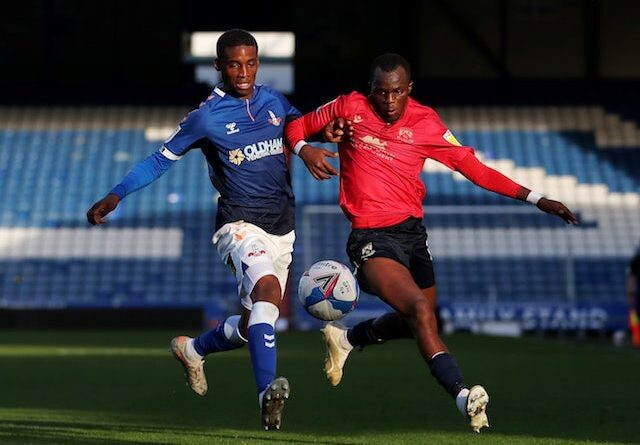 Morecambes Carlos Mendes Gomes in action with Oldham Athletic's Dylan Fage in the second division on October 20, 2020