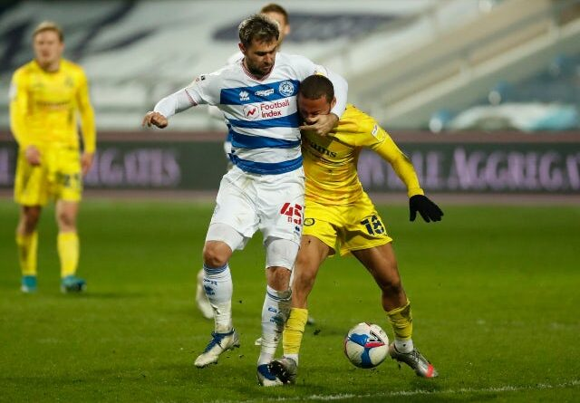 Charlie Austin of Queens Park Rangers in action with Curtis Thompson of Wycombe Wanderers in the championship on March 9, 2021