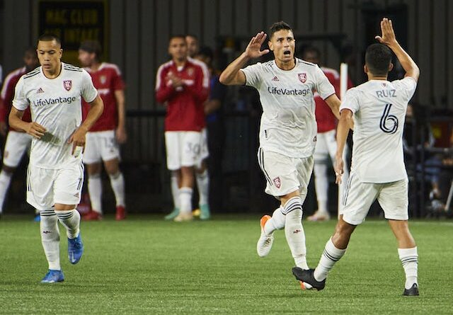 Real Salt Lake midfielder Damir Kreilach (8) celebrates with midfielder Pablo Ruiz (6) after scoring a goal against the Portland Timbers in the second half at Providence Park, pictured on August 7, 2021