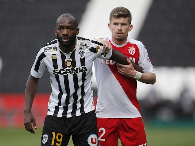 Stephane Bahoken from Angers in action with Caio Henrique from AS Monaco in Ligue 1 in April 2021