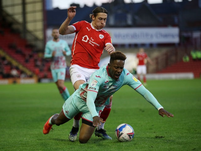 Barnsley's Callum Brittain in action with Swansea City's Jamal Lowe in the Championship Playoffs on May 17, 2021