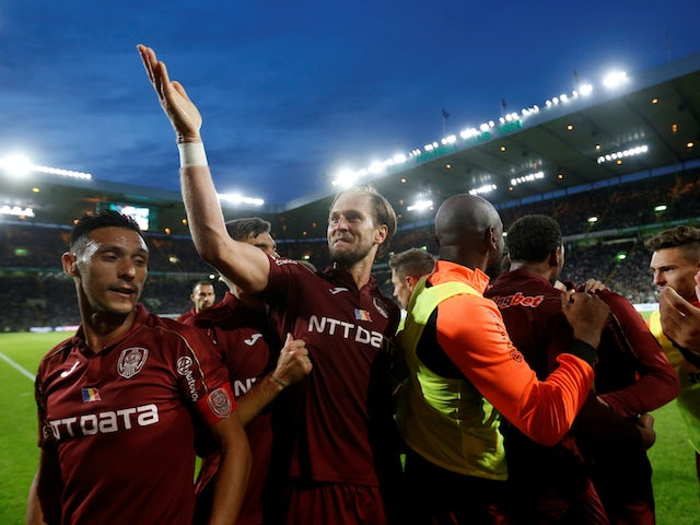 CFR Cluj's Billel Omrani celebrates his second goal with his teammates on August 13, 2019