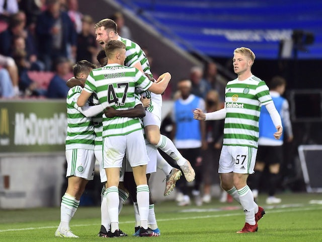 Celtic's Callum McGregor celebrates his first goal with his teammates on July 28, 2021