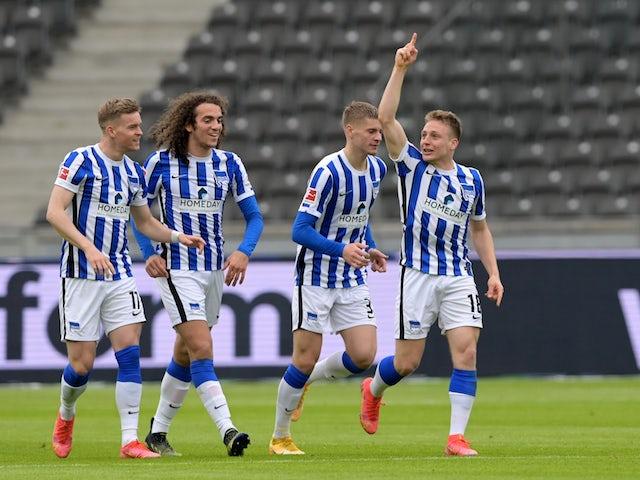 Hertha Berlin's Santiago Ascacibar celebrates its first goal on April 10, 2021