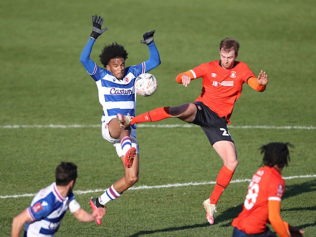 James Bree of Luton Town in action with Jayden Onen of Reading in the third round of the FA Cup on January 9, 2021