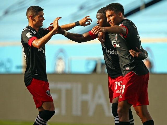 DC United forward Nigel Robertha celebrates his goal with his teammates on June 27, 2021