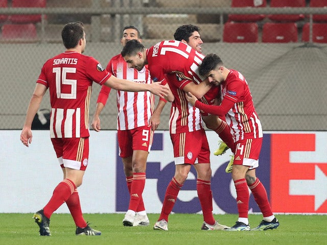 Olympiacos' Giorgos Masouras will celebrate his fourth goal with his teammates in the Europa League on February 18, 2021