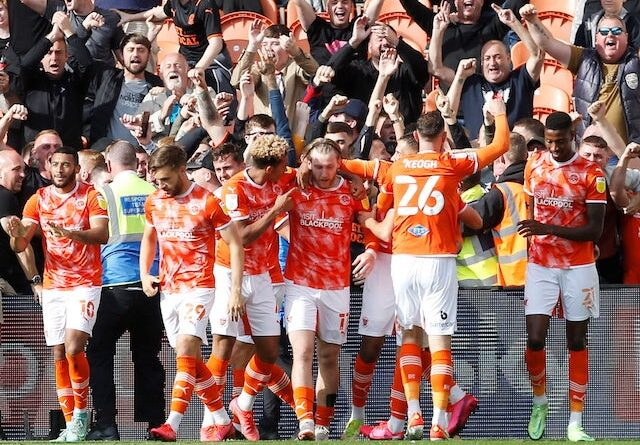 Blackpool's Josh Bowler celebrates with his teammates after scoring his first goal on September 11, 2021