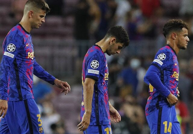 Barcelona's Gerard Pique, Yusuf Demir and Philippe Coutinho look dejected after the September 14, 2021 game