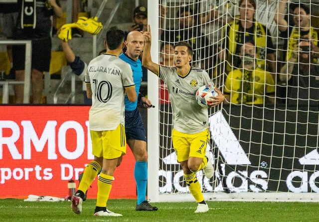 Columbus Crew forward Pedro Santos (7) grabs the ball after scoring in the second half against Atlanta United at Lower.com Stadium on August 8, 2021