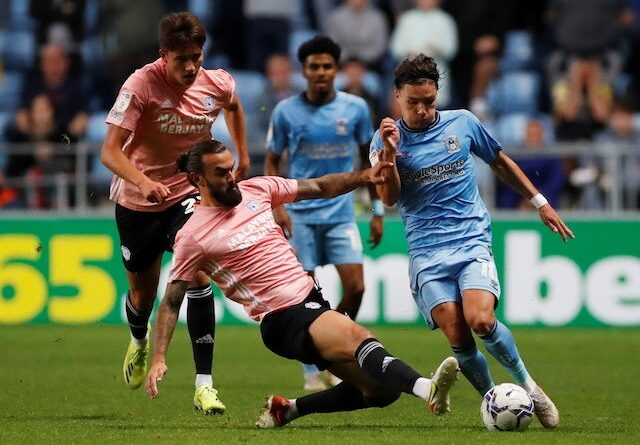 Callum O'Hare of Coventry City in action with the Cardiff City Marlon Pack on September 15, 2021